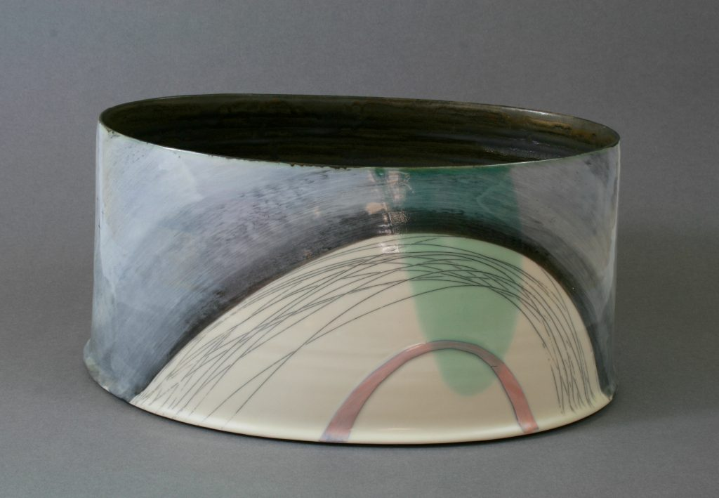 Wheel-thrown and altered porcelain oval form with slip decoration.  Around 34cm width.